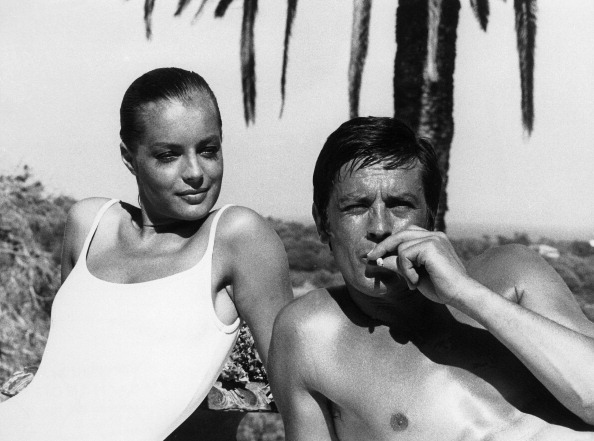 Alain Delon with Romy Schneider (L) (Photo by Keystone-France/Gamma-